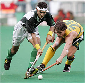 FRONTLINE: Pakistan?s Tariq Aziz, left, is tackled by Australia?s Brent Livermore during their match at the 14th Sultan Azlan S
