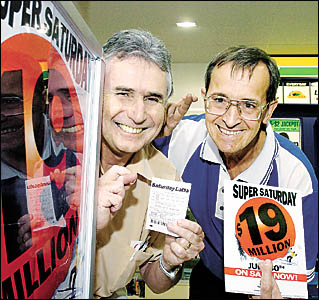 FEELING LUCKY: Tony Conway, left, of Ballina, and the owner of Ballina Newsagency, Geoff Young, have their fingers crossed f