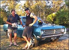 Owner John Bogaart (left) and driver Steven Cameron show the spoils after winning  the Cruzin Magazine Nostalgia Drag Series.