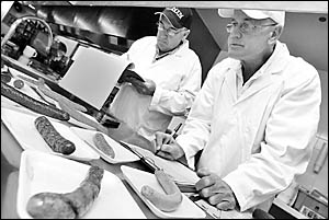 Sausages are a serious business for judges Peter Dunstan and Jim Down as they assess entries in the regional section of the NSW
