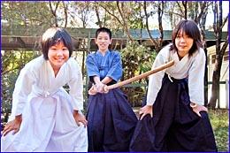 Saki Nakamiya (left), Saitaro Kinoshita and Aya Kouzuma from Jonan Junior High in Saiki City perform kendo.