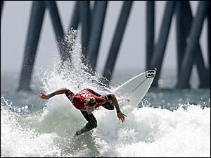 Andy Irons rides a wave as he competes against Rob Machado in men?s final during the US Open of Surfing in Huntington Beach, Ca