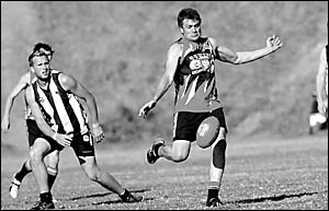 Dave Meyers kicks theSawtell-Toormina Saints onto the attack during the North Coast AFL clash with Port Macquarie at Richardson