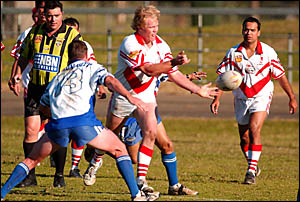 Rebels back-row forward Colby Schrader gets away a pass in yesterday?s local derby against the Grafton Ghosts.