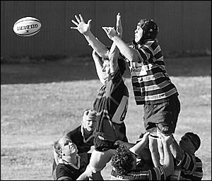 Connor Barrett (left) tries to stop his Hastings Valley opponent getting on top in a lineout during Coffs Rugby?s semi-final wi