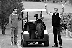 Golfer Ray Lang, right, will be off to the US Open in Augusta next year thanks to the new golf cart he bought from Woolgoolga g