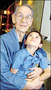 BONDED: Oji Chan (grandfather) with the apple of his eye, six-year-old grandson Taro.