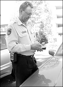 Senior ranger David Brooks test drives one of Coffs Harbour City Council?s new machines for issuing infringement notices.