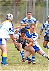 Gladstone Brothers back-rower Matt McConnell tries to evade Yeppoon winger Blair Kidd in Yeppoon?s 56-30 reserve grade win.