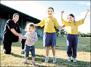 HOME GROWN: Marist Brothers coach Craig Hodges with his own cheer squad warming up for the game against Mullumbimby tomorrow ?