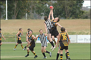 FLYINGHIGH:Tigers ruck forward Jarred Bocconfuso flies high to contest the ball against his Port Macquarie opposite number in l