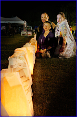 Merv, Reece and Nicole Castledine gave their candles a personal touch  at the Relay for Life.