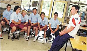 St George-Illawarra fullback, Clint Greenshields talking with a group of children from John Paul College last week. Greenshield