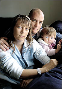 NO BEDS: Leanne Francis with her husband, Shayne, and their daughter Koby, 11 months. Leanne?s surgery was cancelled at the Bas