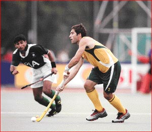 Kiel Brown pushes aside his Pakistani opposition during the Junior World Cup. Picture: SUPPLIED