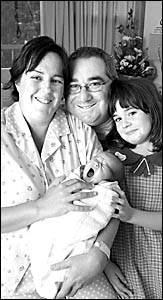 WHAT APOLOGY? Elizabeth Smith and her husband, Michael, with baby Daniel, who was born at the weekend, and daughter Kimberley,
