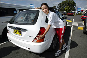 Saskia Parsons of Cudgen shows her fuel-efficient Ford Laser some love, because with rising fuel prices, it pays to have a smal