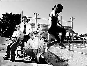 SPLASH: Tanisha Walker, 11, of the Lismore Amateur Swimming Club, jumps watched by Lismore Challenge?s Christine Sheibel, John