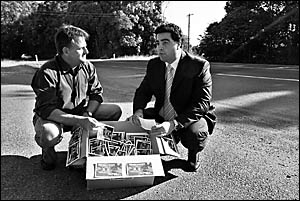NSW Minister for Roads Joe Tripodi (right) said the Highway Hell postcards presented to him yesterday by Coffs Coast Advocate c