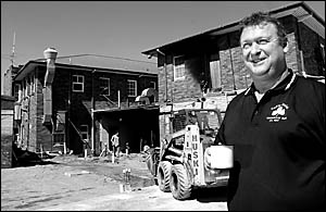 Countdown . . . Marty Phillips will re-open his front bar in three weeks? time in the wake of the blaze which almost destroyed