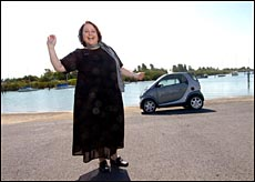 Juliane Silvers is one of the few smiling motorists at the moment. Her smart car is exremely fuel efficient.