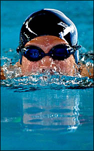 Kayla Ellison breaks the surface during the breaststroke leg of the 100m individual medley.