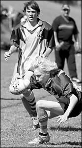 St John?s College Woodlawn fullback Luke Saltmarsh scores one of his three tries in the Under-14 team?s 38-0 Cochrane Cup semi-
