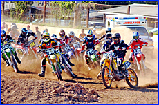 Riders round the first corner in the Clubman Lites event at the Stadium Motocross to benefit Dan Horton on Saturday night.