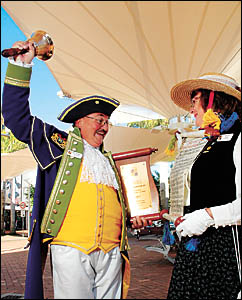 Town crier John Charles Kerr, pictured with his wife, Trish, is back in full voice and celebrating his second-place finish in t