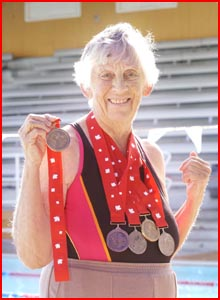 Marjorie Chipperfield with the World Masters swimming medals she won in Canada. Picture: NEVILLE MADSEN