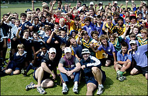 PRIMARY school children from the Tweed have a ball with Broncos representatives, front row from left, development manager Paul