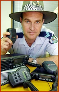 Acting Sergeant Scott McGrath with UHF radios similar to the ones recently stolen. Picture: DEBBIE DRUCE