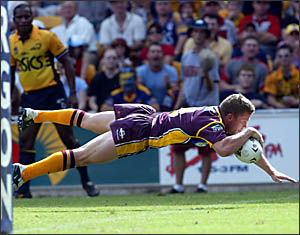FOUR-POINT LANDING: Barry Berrigan scores a spectacular try for the Brisbane Broncos. Yesterday he was passing on tips to local