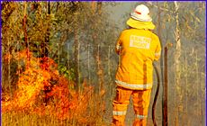 Rural firefighter Allan Gorrey keeps the flames at bay.