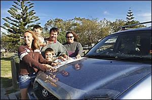 Mackay visitors Teleasha Harvey (left), Joel, Tom, Codi and Trisha Anderson plan the next stop on their holidays, which will se
