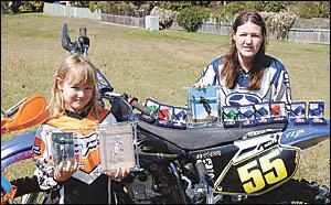 Motocrosse dynamos, Elisha Bates 7, and sister Ashlea, 15 with their trophies.