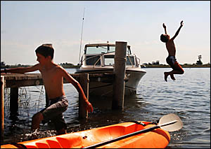 BRAD CHARD, 12, left, and Ben McPhee, 13, of Ulmarra cool off at the Ulmarra River Festival.