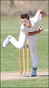 Ben Simms bowling for Coffs Harbour in the under-14 match