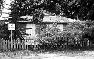 Whites Cottage, a relic of the early 1900s sitting on a site between the Clarks Beach Caravan Park and the Clarks Beach Cafe, i