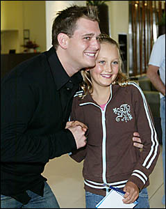 p MICHAEL Buble was happy to sign his autograph and be in a photo yesterday with young fan Emma McCabe, 10, who lives at the Sa