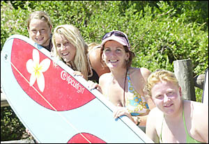 FINALISTS: Longboard finalists check out the conditions at the 15th Evans Head Longboard Invitational, from left, Jessica Whyat