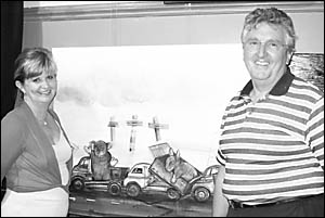 Serena and Ralph Lynch with the winning entry for this year?s $5000 Lynch Art Prize, Pine Creek Revisited by Jacqui Henwood.