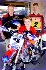 Tannum Sands motocross rider Jake Wright celebrates his second placing with fans Mark (left) and Warren Harris.