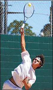 Bryce Cunningham serving during the recent Coffs Harbour Open tennis tournament after attending a coaching camp in the United S