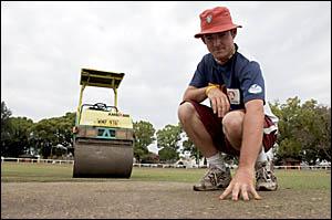 ONA ROLL:Ellem Oval curator John Holmes checks the progress of his preparation of the Ellem Oval wicket.