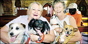 ARMS FULL: Margaret Bryant, of Lismore, needed the help of her friend Kath Hall, of Lismore, to handle her dogs Wilson, Randy,