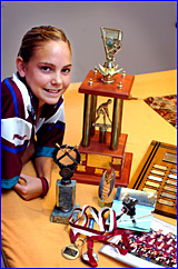 Promising Gladstone hockey player Rachael Nicol with just an assortment of her awards