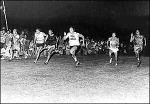 KERRY GODWIN, far left, wins the final of the Brunswick Valley Gift in 1976 from Sydney rugby league winger Tom Mooney, centre