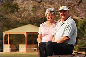 2005 Jacaranda Festival guest of honour Doug Barnier and his wife Denise relax at See Park yesterday.