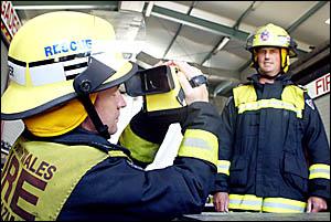 TWEED Fire Station senior officers Richard Fraser and Darren West demonstrate the thermal-imaging camera.